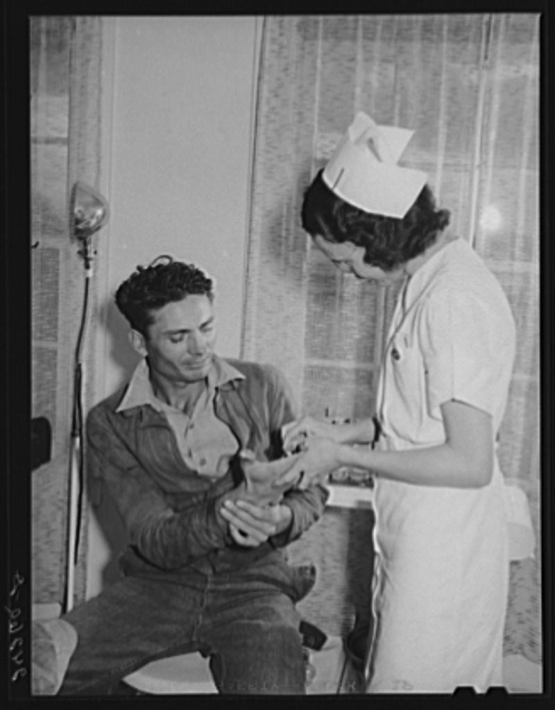 Patient receiving medical aid in health clinic. Shafter migrant camp. Shafter, California