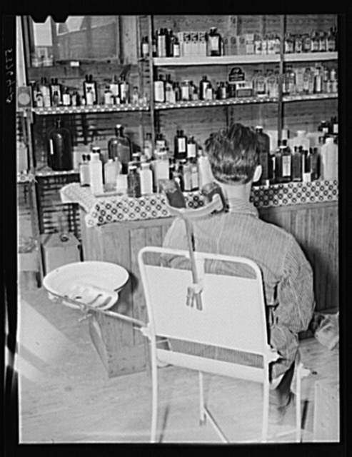 Patient waiting in the doctor's office, rear of country store. Faulkner County, Arkansas