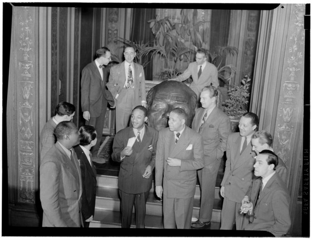 [Portrait of Ahmet M. Ertegun, Mezz Mezzrow, Art Hodes, Nesuhi Ertegun, Herb Abramson, Benny Morton(?), Jay Higginbotham, Henry Allen, Lou McGarity, Lester Young, and Sadi Coylin, Turkish Embassy, Washington, D.C., ca. 1940]