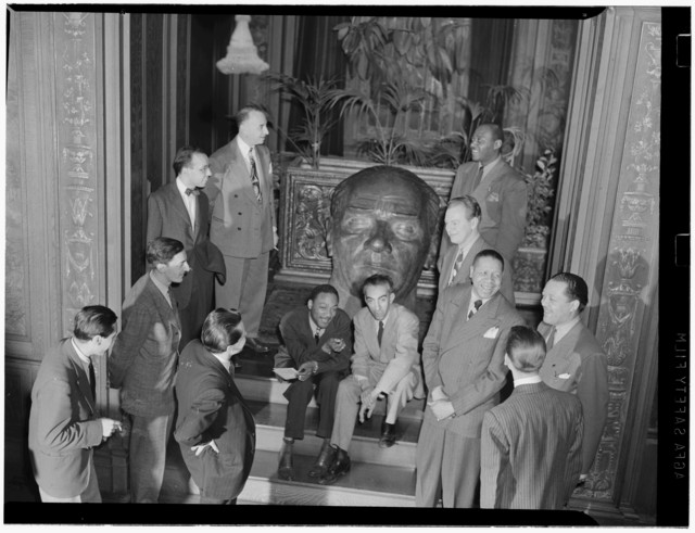 [Portrait of Nesuhi Ertegun, Herb Abramson, Ahmet M. Ertegun, Mezz Mezzrow, Jay Higginbotham(?), Art Hodes, Lou McGarity, Henry Allen, Lester Young, and Sadi Coylin(?), Turkish Embassy, Washington, D.C., ca. 1940]