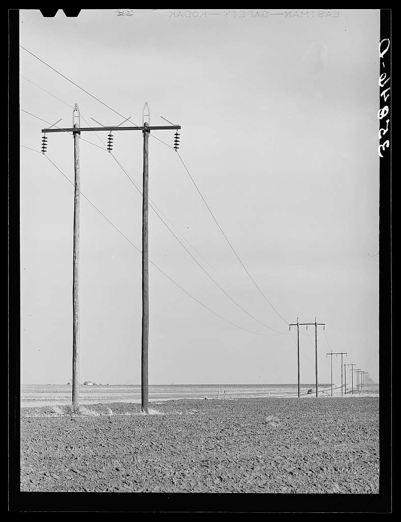 Power lines along highway in Dawson County, Texas