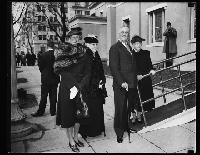 PRESIDENT ROOSEVELT OBSERVES SEVENTH ANNIVERSARY IN WHITE HOUSE. PRESIDENT FRANKLIN D. ROOSEVELT BEGINS HIS EIGHTH YEAR IN THE WHITE HOUSE TODAY AND OBSERVED THE ANNIVERSARY OF HIS INAUGURATION BY ATTENDING SERVICES AT ST. JOHN'S EPISCOPAL CHURCH TODAY. THE PRESIDENT, TANNED AND RUGGED FROM HIS SEA TRIP, WAS JOINED AT THE CHAPEL BY A GROUP OF HIS CLOSEST GOVERNMENT INTIMATES, CABINET MEMBERS, CONGRESSIONAL LEADERS AND ADVISORS. THIS PICTURE WAS TAKEN AFTER THE SERVICES-L TO R: MRS. FRANKLIN D. ROOSEVELT; MRS. SARA DELANO ROOSEVELT, MOTHER OF THE PRESIDENT; PRESIDENT ROOSEVELT; AND MRS. ENDICOTT PEABODY, WIFE OF THE HEAD MASTER OF GROTON SCHOOL WHERE MR. ROOSEVELT PREPARED FOR HARVARD