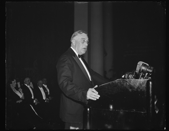 PRESIDENT SPEAKS ON BELGIAN INVASION. WASHINGTON, D.C. MAY 10. PRESIDENT ROOSEVELT TONIGHT ADDRESSED THE EIGHTH AMERICAN SCIENTIFIC CONGRESS AT CONSTITUTION HALL AFTER ONE OF THE BUSIEST DAYS IN HIS ADMINISTRATION FOLLOWING THE GERMAN INVASION OF BELGIUM, HOLLAND, AND LUXEMBOURG. SEEMING WEARY, HE TOLD THE GROUP THAT THE UNITED STATES WAS SADDENED BY THE WAR, BUT THAT HE WAS PROUD THAT IT WAS SAD