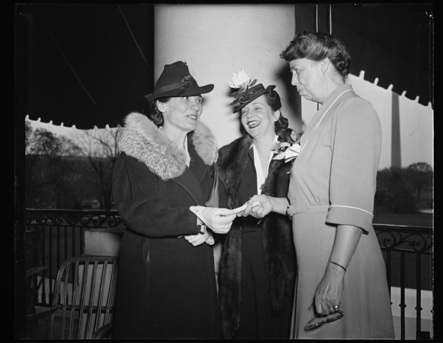 PREVIEW TO WOMAN'S NATIONAL DEMOCRATIC SPRING FETE. WASHINGTON, D.C. APRIL 23. THE WOMAN'S NATIONAL DEMOCRATIC CLUB WILL HOLD ITS SPRING FETE AT THE SHOREHAM HOTEL TERRACE IN WASHINGTON, D.C. ON MAY 4, 1940. MRS. FRANKLIN D. ROOSEVELT WILL BE HONORARY CHAIRMAN OF THE RECEPTION COMMITTEE, RECEIVING WITH WIVES OF MEMBERS OF THE CABINET. IN THE PICTURE, MRS. ROOSEVELT RECEIVES TICKET NO. 1. L TO R: MRS. HALE E. SHNEFIELD, TICKET CHAIRMAN OF THE MAY FETE; MRS. CLAUDE PEPPER, WIFE OF THE SENATOR FROM FLORIDA AND GENERAL CHAIRMAN OF THE FETE; AND MRS. ROOSEVELT