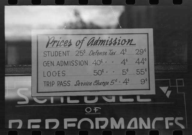Price schedule in front of moving picture show. Redding, California
