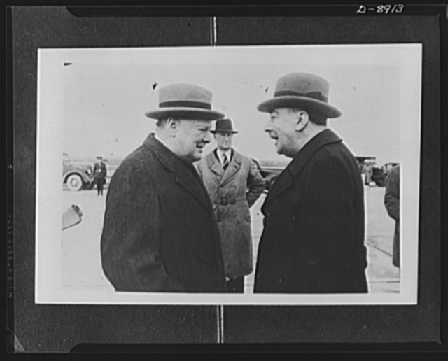Prime Minister Winston Churchill and president of Turkey. Churchill talking to Menemencioglu, Turkish foreign minister, at the airport on Churchill's arrival at Adana for conference with Inonu, president of Turkey