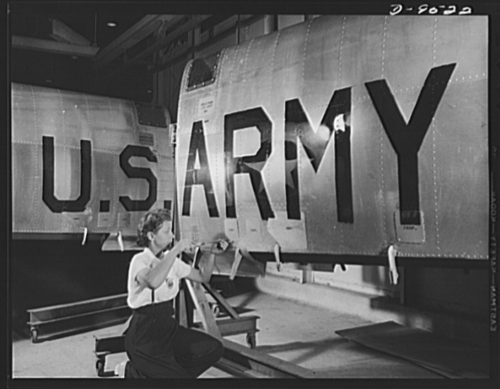 "Production. BT-13A (""Valiant"") basic trainers. Final inspection of a wing for a ""Valiant"" basic trainer at Vultee's Downey, California plant. At the Downey plant is made the BT-13A (""Valiant"") basic trainer--a fast, sturdy ship powered by a Pratt and Whitney Wasp engine"