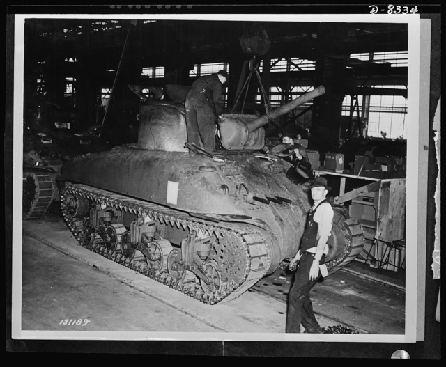 Production. M-4 tanks. Cannon and front turret armored plate are lowered into place on an M-4 tank. Machine guns have already been installed and the General Sherman will be ready for the test track. Designed by the Army Ordnance Department and built under ordnance supervision, the M-4 embodies new advances in design based on battlefront experience. Cast steel construction of the hull expedites production