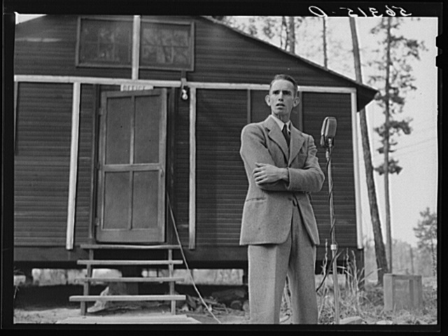 Prominent farmer and member of the land use planning committee speaking at a picnic and barbecue at the CCC (Civilian Conservation Corps) camp after a meeting in the courthouse in Yanceyville. Caswell County, North Carolina