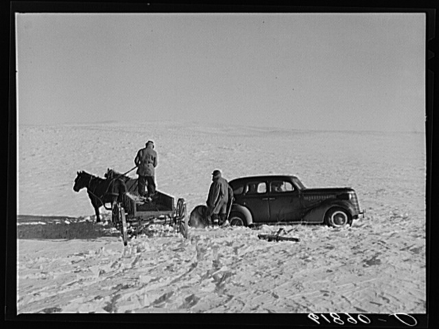 Pulling government car out of snow drift. Todd County, South Dakota