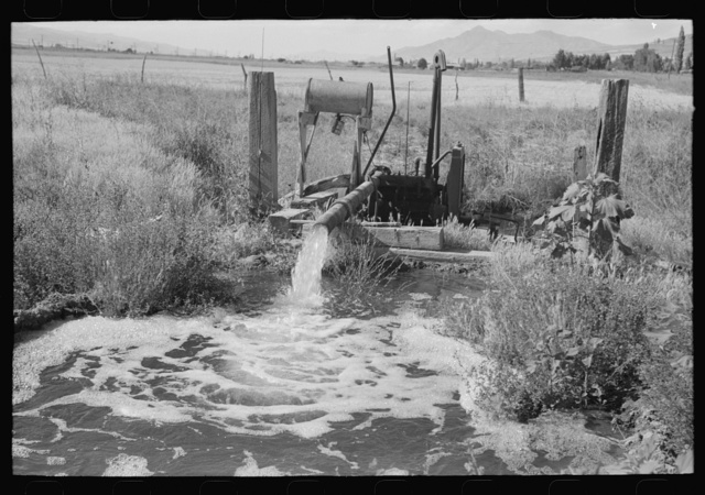 Pumping water which was excess in irrigating one field to a higher level to be used again for irrigation. Box Elder County, Utah