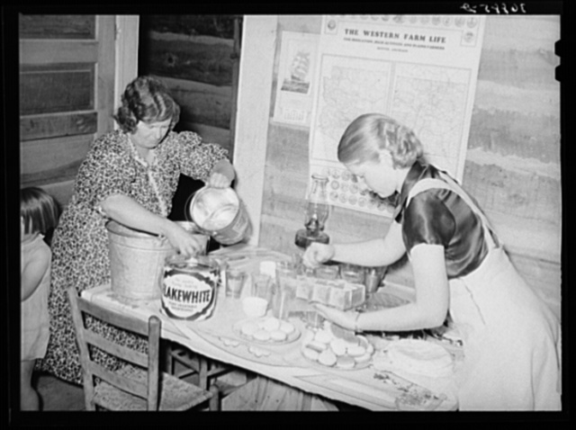 Putting out the refreshments, cakes, cookies and lemonade at the square dance. Pie Town, New Mexico