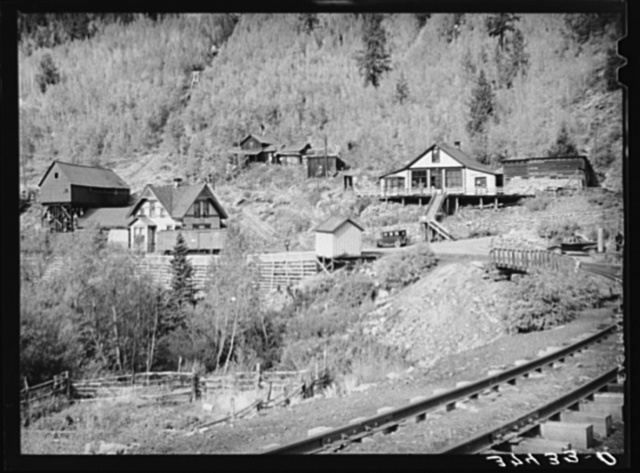 Railroad station and liquor store at Ophir, Colorado. A narrow gauge railway runs into the town with supplies and takes out the ore