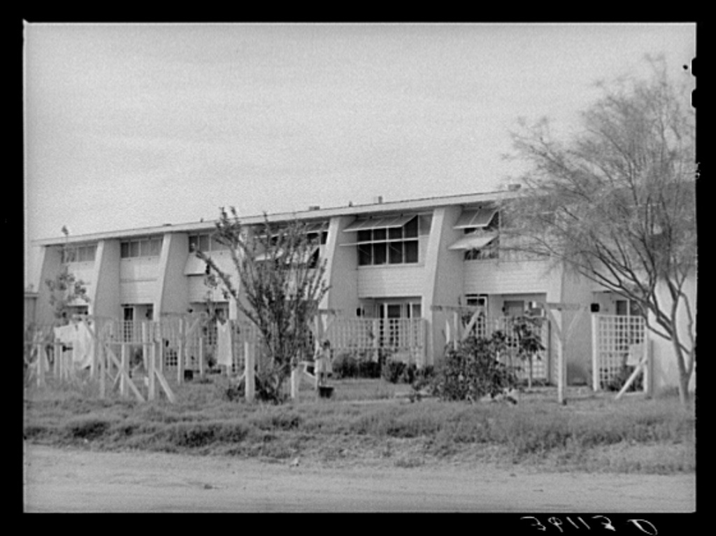 Rear view of apartment houses at the Arizona part-time farms. Chandler Unit, Maricopa County, Arizona
