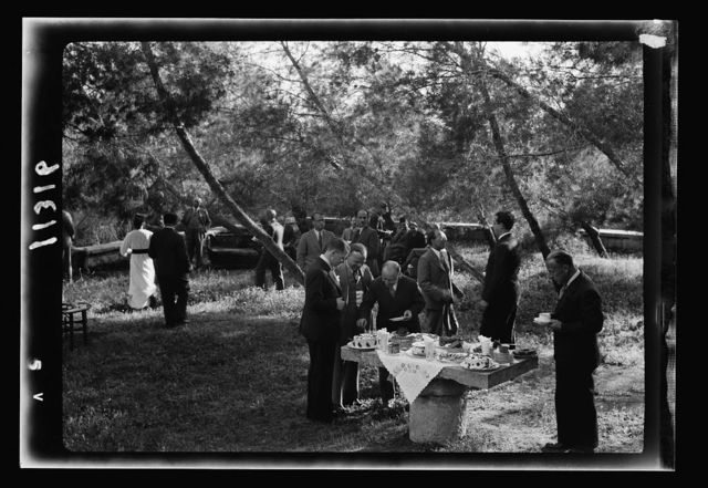 Reception by the Director of Programmes, Palestine Broadcasting Service. The bouffet [i.e., buffet] in the garden