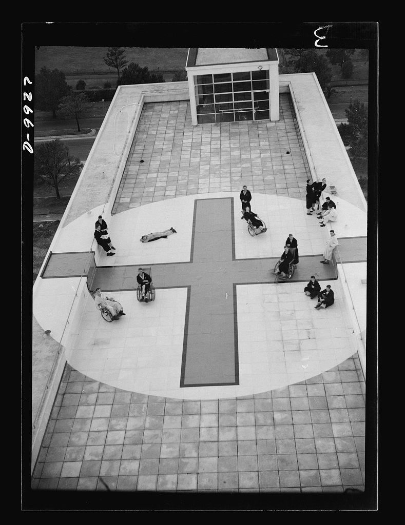 "Reciprocal aid. American soldiers, sailors, and marines, recuperating from wounds and illness on roof of a new 3 million dollae hospital which government of Australia, without cost to the United States has provided for our forces, ""somewhere in Australia."" Huge red cross identifies building for passing airplanes. Hospital is one of many facilities given the United States by Australia as reciprocal lend-lease"