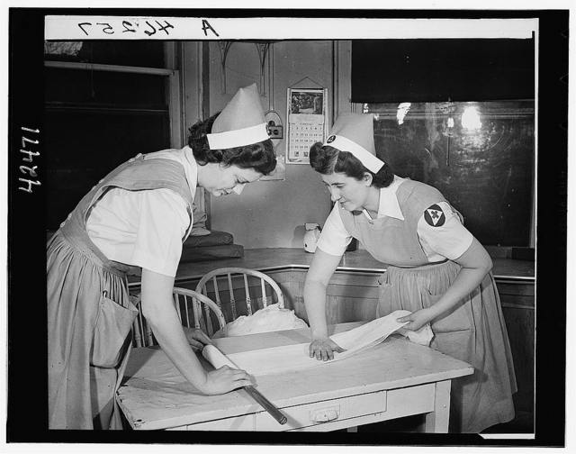 Red Cross nurses' aides preparing surgical bandages