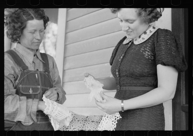 Rehabilitation borrower showing lace work she has made to home supervisor, Grant County, Illinois