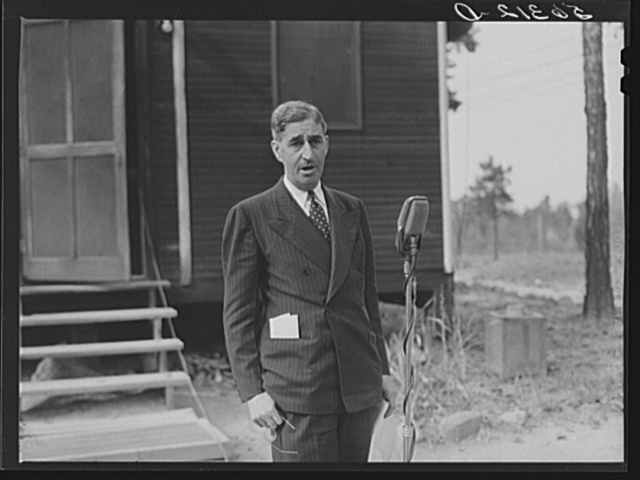 Representative A.L. Folger speaking at a picnic lunch and barbecue on the grounds of the CCC (Civilian Conservation Corps) camp. This followed a meeting of the county land use planning committee in the courthouse in Yanceyville, Caswell County, North Carolina