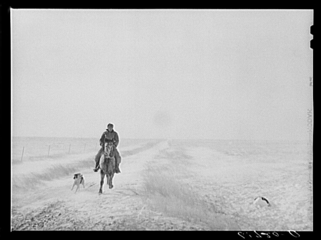 Riding out to bring the cattle. First stages of snow blizzard. Lyman County South Dakota
