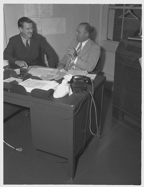 R.J. Lund, consultant on miscellaneous minerals, Materials Branch, Production Management (right). Robert H. Ridgway (left), consultant for scrap iron and steel, Materials Branch, Production Division