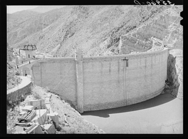 Roosevelt Dam showing small amount of impounded water because of extended drought. This is the main source of water for irrigation in the Salt River Valley. Gila County, Arizona