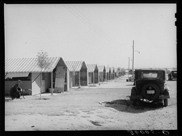Rows of metal shelters for agricultural workers at the Aqua Fria migratory labor camp. Arizona