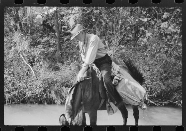 Rural mailman going up the creek bed toward Morris Fork near Jackson, Kentucky
