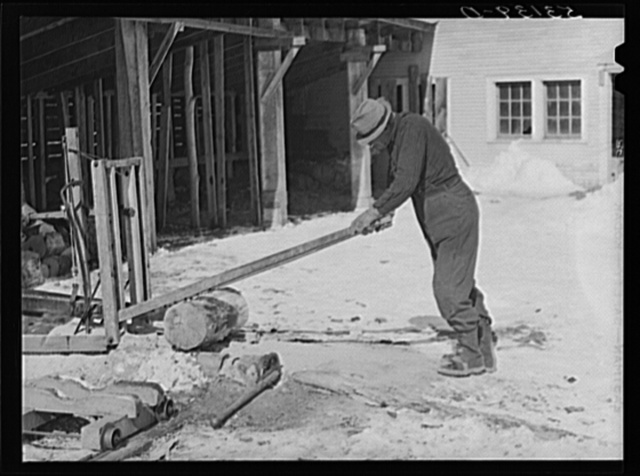 Sawing wood on farm. Woodstock, Vermont