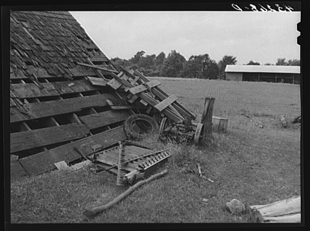 Scattered implements in barnyard on farm near Rockville, Maryland