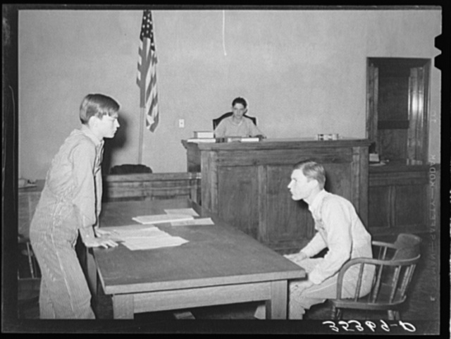 Scene from a one-act play presented at county meeting of 4-H Club. This play was in the form of a trial of Farmer Brown who was charged with cruelty to his farm. Eufaula, Oklahoma