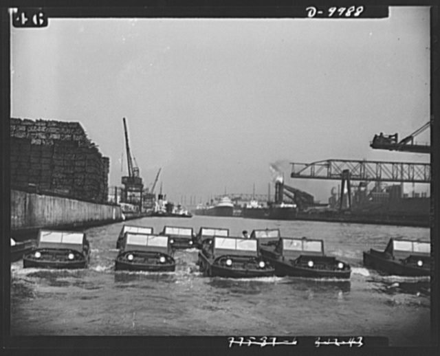 """Sea jeeps. A """"squad"""" of nine Ford-built amphibian cars in formation """"swimming"""" in the Rouge River near the company's plant"""