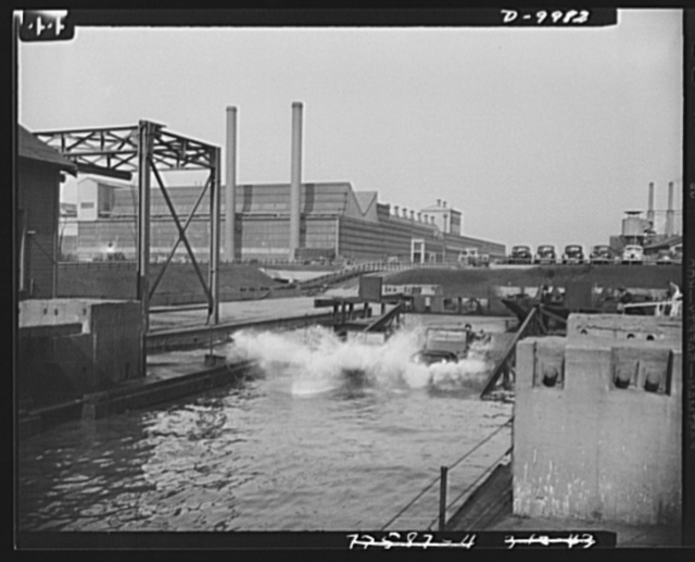 Sea jeeps. This amphibian car hits the water with a splash during a try-out at the Ford Motor Company's Rouge plant. All of the cars are water-tested in this slip before they are turned over to the government for use on various war fronts