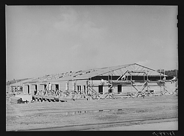 Series of barracks under construction at the replacement cantonment of the coast artillery. San Diego, California