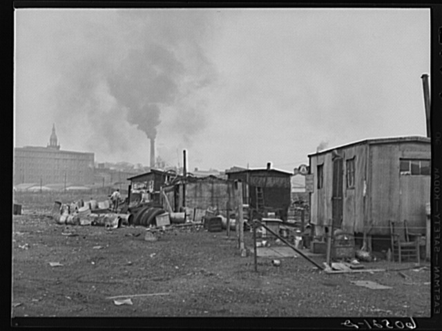 Shacks on edge of city dump, occupied by men who gain their living by salvaging of scrap iron, old tires, paper which they bale, etc. Dubuque, Iowa