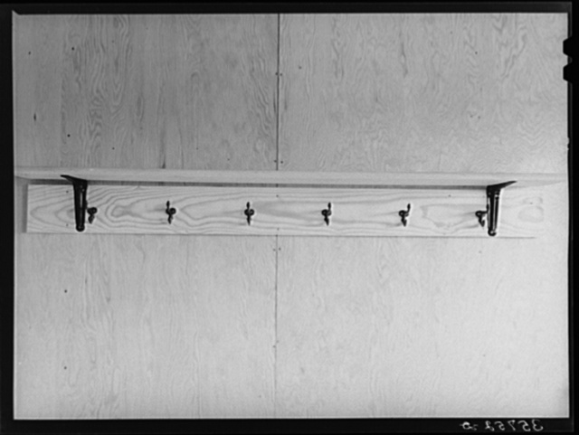 Shelf and hooks in one of the row shelters for migratory workers at the migratory labor camp at Sinton, Texas