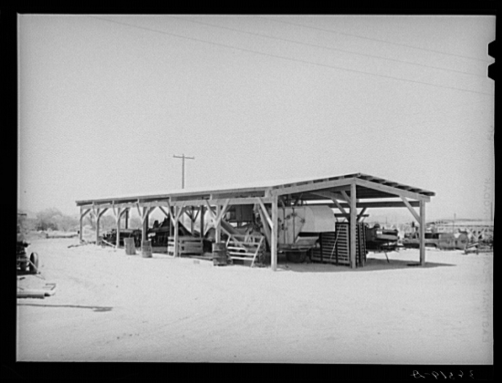 Shelter for farm machinery at the Casa Grande Valley Farms. Pinal County, Arizona