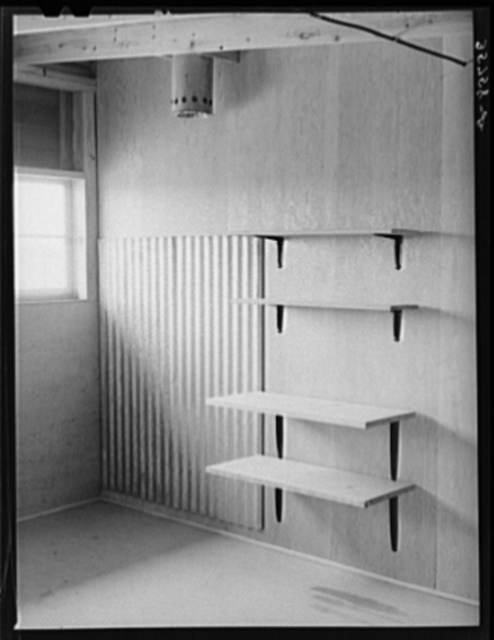 Shelves which will serve as storage space for kitchen equipment in one of the row shelters for migratory workers at the migratory labor camp. Sinton, Texas