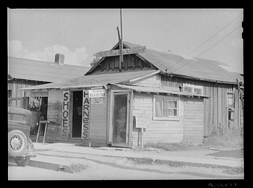 Shoe and harness repair shop and beauty shop. Shelby, Mississippi