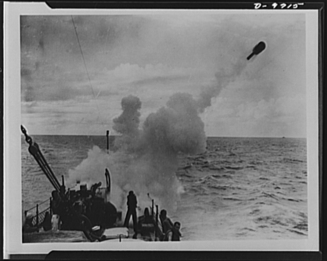 "Shopping for victory with war bonds. This is a war bond in action! That ashcan hurtling through the air, fired from a Y gun on a PC boat, is a depth charge containing potential death for a lurking submarine. It is in action because somebody bought $105 worth of war bonds. That's what the ""ashcan"" cost"