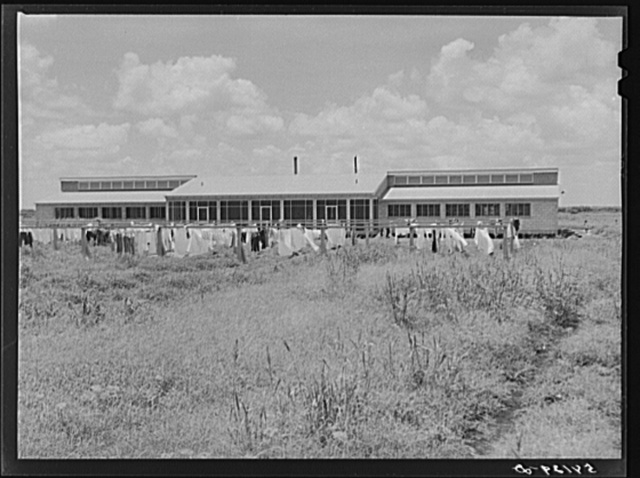 Showers for both babies and older children and for parents and complete laundry facilities are provided for members of the Okeechobee migratory labor camp. Belle Glade, Florida