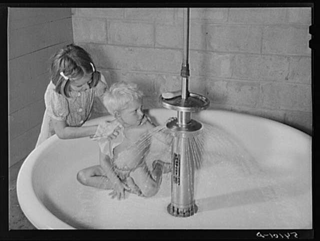 Showers for both babies and older children and for parents and complete laundry facilities are provided in the utility building for members in the utility building for members of the Osceola migratory labor camp. Belle Glade, Florida