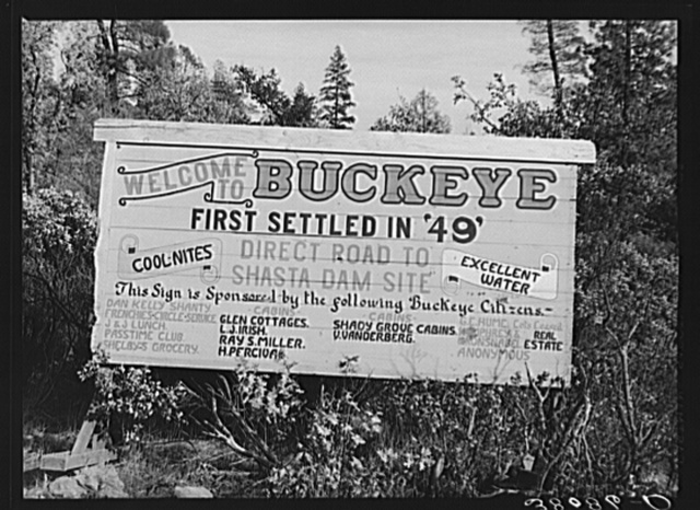 Sign at city limits of Buckeye, Shasta County, California. This is an old town, now become a boom town, because of construction work at Shasta Dam