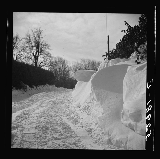 Snow drifts and driveway along main highway near Rockville, Maryland. Montgomery County, Maryland