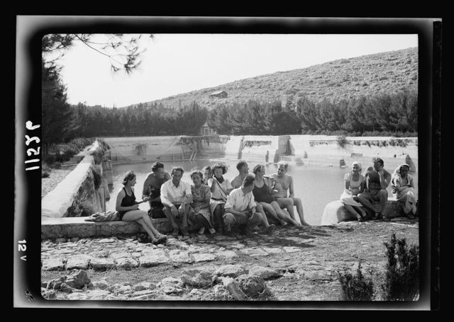 Solomon's pools becomes a picnic & swimming resort. Group of bathers in the edge of the lower pool