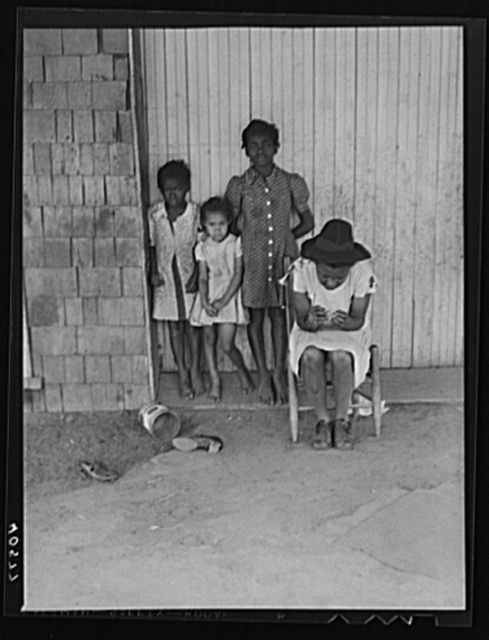 Some of the people living in an old garage converted into a dwelling. Outskirts of Graham, Alamance County, North Carolina
