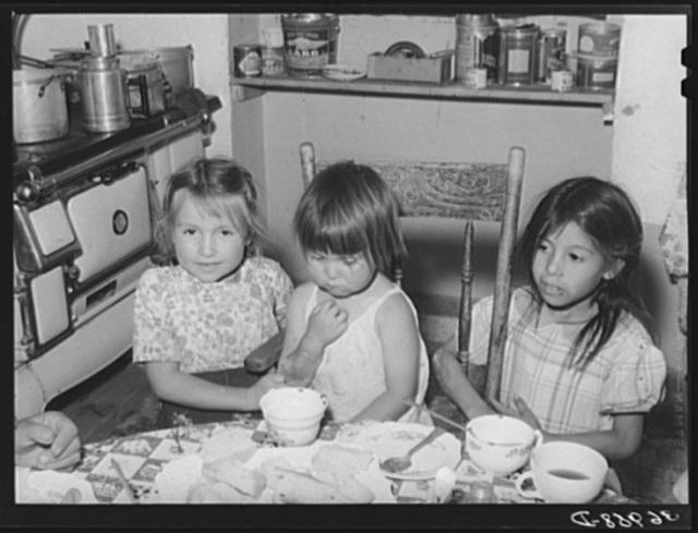 Spanish-American children at the dinner table. Chamisal, New Mexico