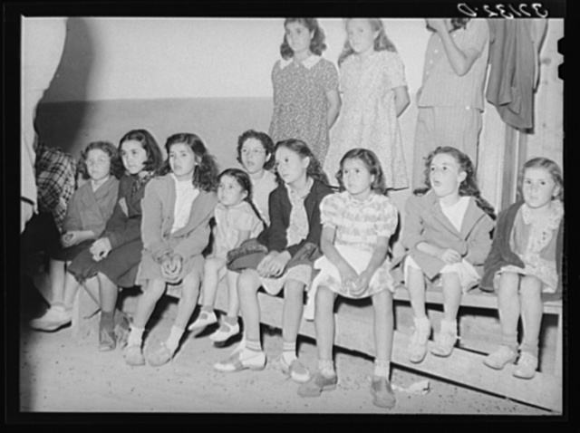 Spanish-American children watching show. Penasco, New Mexico