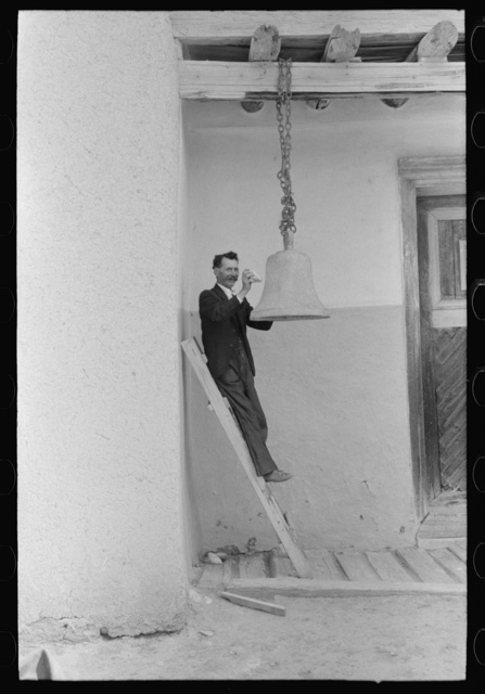 Spanish-American ringing bell with rock at the Church of the Twelve Apostles, Trampas, New Mexico. Church is 350 years old
