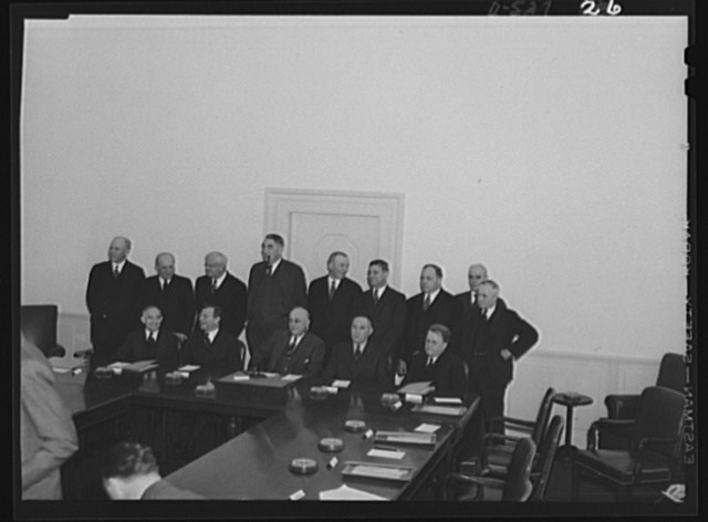 Standing, left to right: Undersecretary of Labor; Eugene Meyer, publisher of the Washington Post; Roger D. Lapham, president of the American Hawaiian Steamship Company; Cyrus Ching, Vice President, U.S. Rubber Corporation; Walter C. Teagle, former President, Standard Oil Company of New Jersey; George M. Harrison, grand president, Brotherhood of Railway and Steamship Clerks; George Meany, general secretary of the AFL (American Federation of Labor); Philip Murray, CIO (Congress of Industrial Organizarions) President; Thomas Kennedy, secretary treasurer, United Mine Workers (UMW). Seated, left to right: Frank P. Graham, University of North Carolina President; Sidney Hillman, Associate Director General representing the Office of Production Management; Chairman Clarence Dykstra; Daniel Tracy, second Assistant Secretary of Labor; William H. Davis, Vice-Chairman, new Mediation Board, former Chairman of New York state mediation board